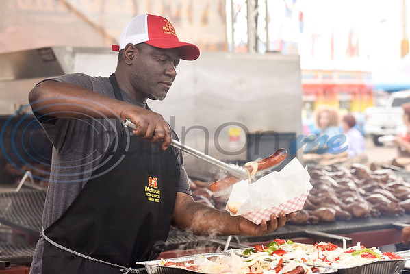 A man who asked to not be named prepares a dish with sausage, onions and peppers at the East Texas State Fair in Tyler, Texas, on Friday, Sept. 21, 2018. (Chelsea Purgahn/Tyler Morning Telegraph)