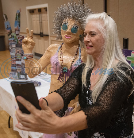 """Anna Carson takes a selfie with """"Moonbeam,"""" an art creation Sylvia Morse, during the Peace Meal for the Art of Peace Week at the Ornelas Activity Center on Saturday Sept. 21, 2019.  (Sarah A. Miller/Tyler Morning Telegraph)"""