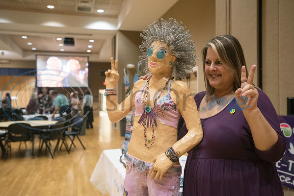 """Artist Sylvia Morse takes a photo with her creation called """"Moonbeam"""" during the Peace Meal for the Art of Peace Week at the Ornelas Activity Center on Saturday Sept. 21, 2019.  (Sarah A. Miller/Tyler Morning Telegraph)"""