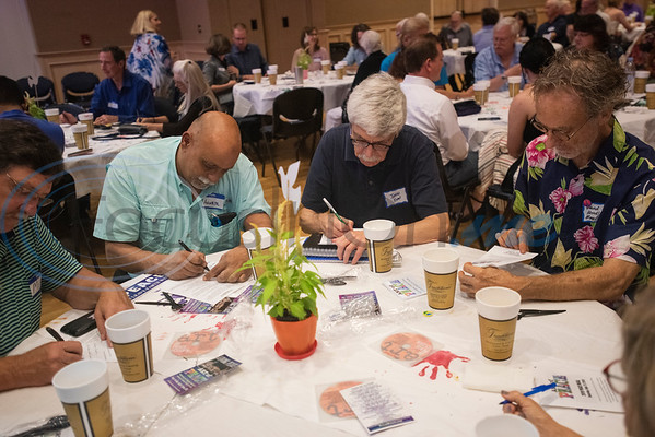 People attending the Peace Meal for the Art of Peace Week at the Ornelas Activity Center write down notes about a person in Tyler who inspires peace on Saturday Sept. 21, 2019.  (Sarah A. Miller/Tyler Morning Telegraph)