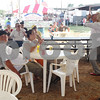 Sam Hartsfield and Judy Green watch from their table as sword swallower Dan Meyer performs Friday Sept. 23, 2016 at the East Texas State Fair in Tyler.<br /> <br /> (Sarah A. Miller/Tyler Morning Telegraph)
