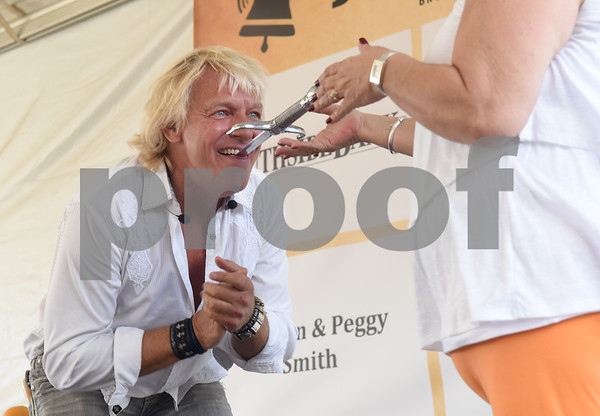 Sword swallower Dan Meyer performs with help from audience member Judy Green of Chandler Friday Sept. 23, 2016 at the East Texas State Fair in Tyler.  (Sarah A. Miller/Tyler Morning Telegraph)