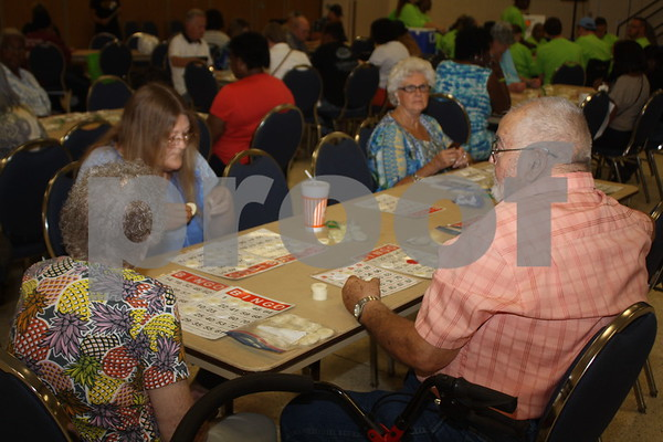 Senior citizens play bingo at the East Texas State Fair.