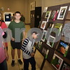 Visitors look at the winning photographs at the East Texas State Fair.