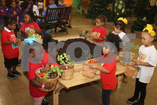 Young students learn about gardening at the East Texas State Fair.