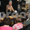 Senior citizens watch a cooking demonstration by Steve Evans at the East Texas State Fair.