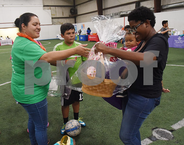 Alexandria Claborn and her daughter Kinsey, 1, win a gift basket during the Catholic Charities Family Fun Day at Tyler Indoor Sports Complex Saturday Sept. 24, 2016.  (Sarah A. Miller/Tyler Morning Telegraph)
