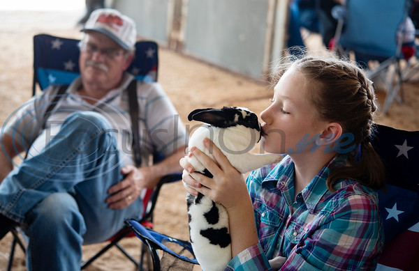 Tom Green County FFA student Mattie Vaughn, 11, kisses her Mini Rex rabbit before the start of the Junior Rabbit Show at the East Texas State Fair in Tyler on Tuesday Sept. 24, 2019.  (Sarah A. Miller/Tyler Morning Telegraph)