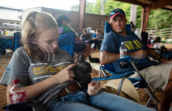 Katie Westerman, 12, of Chapel Hill FFA, holds her Blue Polish rabbit before the start of the Junior Rabbit Show at the East Texas State Fair in Tyler on Tuesday Sept. 24, 2019.  (Sarah A. Miller/Tyler Morning Telegraph)