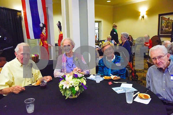 """Ted House, Claryce House, Billie Jenkins and Jim Jenkins pose for a photo during an open house event at The Hamptons in Tyler, Texas, on Thursday, Sept. 28, 2017. The event's theme was """"Around the World"""" and featured food and dessert from various countries. Attendees could also tour the newly-renovated facilities. (Chelsea Purgahn/Tyler Morning Telegraph)"""