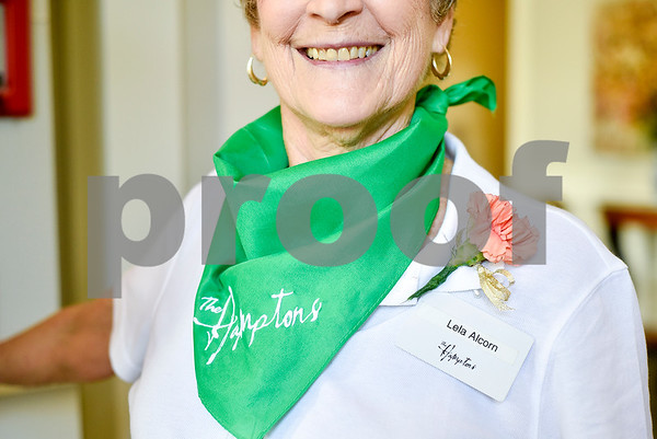 """Lela Alcorn wears a Hamptons bandana and smiles as she holds the door open during an open house event at The Hamptons in Tyler, Texas, on Thursday, Sept. 28, 2017. The event's theme was """"Around the World"""" and featured food and dessert from various countries. Attendees could also tour the newly-renovated facilities. (Chelsea Purgahn/Tyler Morning Telegraph)"""