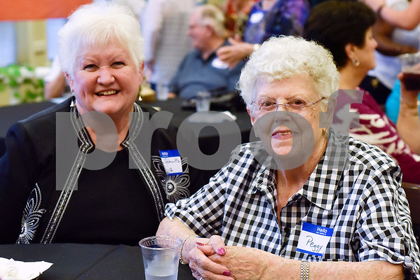 """Peggy Hilton and Judi Schultz pose for a photo during an open house event at The Hamptons in Tyler, Texas, on Thursday, Sept. 28, 2017. The event's theme was """"Around the World"""" and featured food and dessert from various countries. Attendees could also tour the newly-renovated facilities. (Chelsea Purgahn/Tyler Morning Telegraph)"""