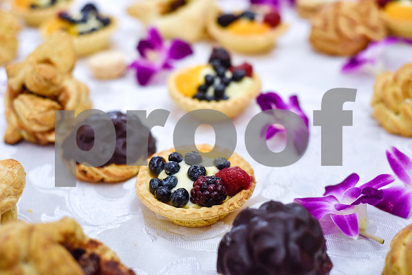 """Dessert at an open house event at The Hamptons in Tyler, Texas, on Thursday, Sept. 28, 2017. The event's theme was """"Around the World"""" and featured food and dessert from various countries. Attendees could also tour the newly-renovated facilities. (Chelsea Purgahn/Tyler Morning Telegraph)"""