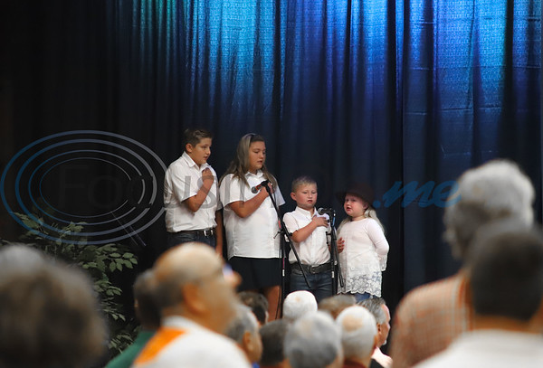 Grandchildren of the late Pierre de Wet perform the National Anthem for the guests of the 11th Annual Robert L Breckenridge Men's Breakfast hosted at KE Bushmans in Bullard. Sarah Perez/Freelance