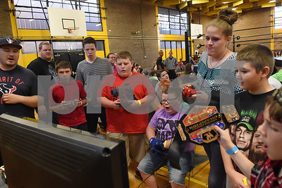 Both children and adults compete in the No Mercy video game tournament during Unleashed, presented by League of Lions Professional Wrestling in association with Jericho Tours Of Tyler Saturday Sept. 3, 2016 at Early College High School in Tyler. The professional wrestling event included both local and international wrestlers.    (Sarah A. Miller/Tyler Morning Telegraph)