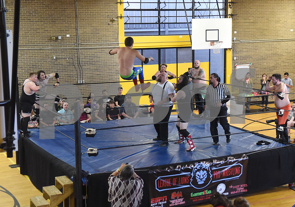 A wrestler jumps off the ring during Unleashed, presented by League of Lions Professional Wrestling in association with Jericho Tours Of Tyler Saturday Sept. 3, 2016 at Early College High School in Tyler. The professional wrestling event included both local and international wrestlers.    (Sarah A. Miller/Tyler Morning Telegraph)