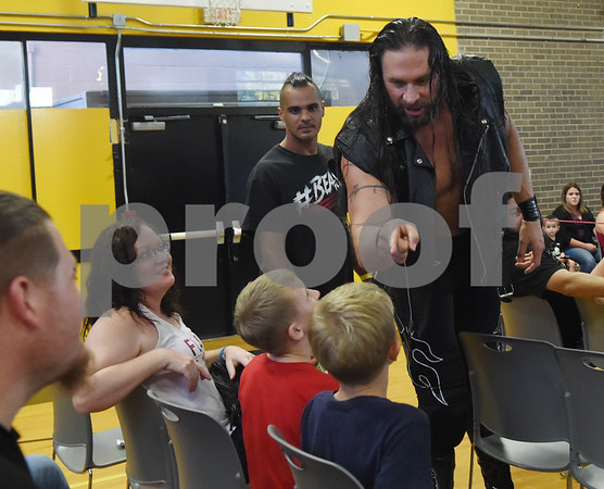 Lane Archer tells young fan Adam Vickers, 9, of Lindale, to sit still as he prepares to enter the ring for Unleashed, presented by League of Lions Professional Wrestling in association with Jericho Tours Of Tyler Saturday Sept. 3, 2016 at Early College High School in Tyler. The professional wrestling event included both local and international wrestlers.    (Sarah A. Miller/Tyler Morning Telegraph)