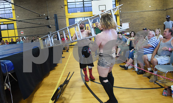 Justin Sane throws a ladder at Andy Dalton during Unleashed, presented by League of Lions Professional Wrestling in association with Jericho Tours Of Tyler Saturday Sept. 3, 2016 at Early College High School in Tyler. The professional wrestling event included both local and international wrestlers.    (Sarah A. Miller/Tyler Morning Telegraph)