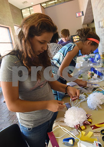 Hogg Middle School eight grader Laraina Flores makes a mum during a homecoming mum making workshop held at the Tyler Public Library Saturday Sept. 3, 2016. An additional homecoming mum workshop will be held at the library on Sept. 17.   (Sarah A. Miller/Tyler Morning Telegraph)