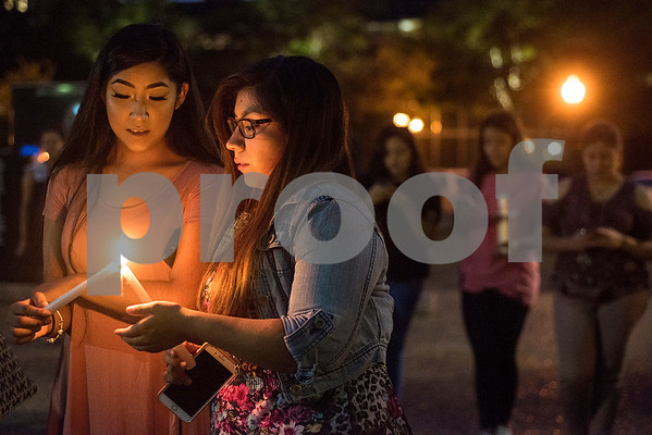 Josselyn and Blanca Villanueva hold candles during a silent vigil in honor of Deferred Action for Childhood Arrivals (DACA) at T.B. Butler Fountain Plaza in Tyler, Texas, on Tuesday, Sept. 5, 2017. Nearly 500 people attended the vigil on the day that the Trump administration announced that they would phase out the program. (Chelsea Purgahn/Tyler Morning Telegraph)
