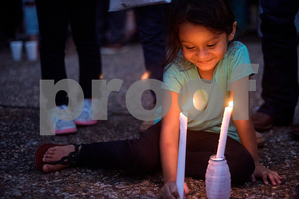 Elizabeth Martinez, 6, smiles as she holds a candle during a silent vigil in honor of Deferred Action for Childhood Arrivals (DACA) at T.B. Butler Fountain Plaza in Tyler, Texas, on Tuesday, Sept. 5, 2017. Nearly 500 people attended the vigil on the day that the Trump administration announced that they would phase out the program. (Chelsea Purgahn/Tyler Morning Telegraph)
