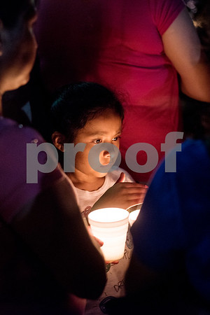 Xitlaly Gonzalez, 8, holds a candle during a silent vigil in honor of Deferred Action for Childhood Arrivals (DACA) at T.B. Butler Fountain Plaza in Tyler, Texas, on Tuesday, Sept. 5, 2017. Nearly 500 people attended the vigil on the day that the Trump administration announced that they would phase out the program. (Chelsea Purgahn/Tyler Morning Telegraph)