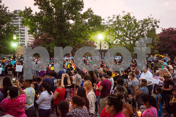 People stand in silence during a silent vigil in honor of Deferred Action for Childhood Arrivals (DACA) at T.B. Butler Fountain Plaza in Tyler, Texas, on Tuesday, Sept. 5, 2017. Nearly 500 people attended the vigil on the day that the Trump administration announced that they would phase out the program. (Chelsea Purgahn/Tyler Morning Telegraph)