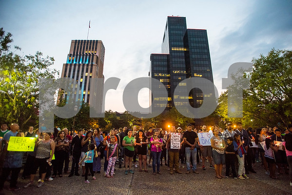 People stand in silence with candles and signs during a silent vigil in honor of Deferred Action for Childhood Arrivals (DACA) at T.B. Butler Fountain Plaza in Tyler, Texas, on Tuesday, Sept. 5, 2017. Nearly 500 people attended the vigil on the day that the Trump administration announced that they would phase out the program. (Chelsea Purgahn/Tyler Morning Telegraph)
