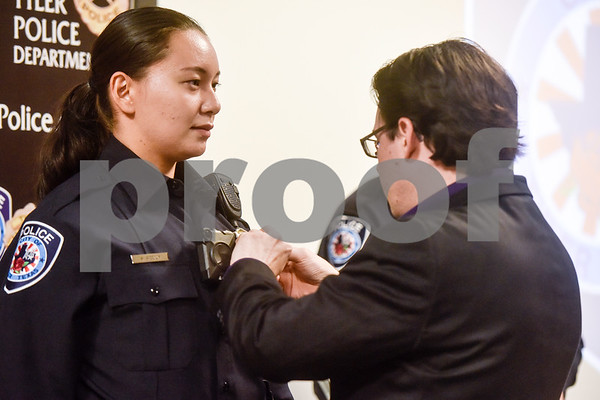 April Peddy is pinned with her new badge at the Tyler Police Department in Tyler, Texas, on Tuesday, Sept. 4, 2018. Seven new police recruits were sworn in and received their badges during the ceremony. (Chelsea Purgahn/Tyler Morning Telegraph)