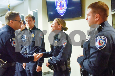 Police Chief Jimmy Toler shakes Amber Thomas' hand after swearing in the new recruits at the Tyler Police Department in Tyler, Texas, on Tuesday, Sept. 4, 2018. Seven new police recruits were sworn in and received their badges during the ceremony. (Chelsea Purgahn/Tyler Morning Telegraph)