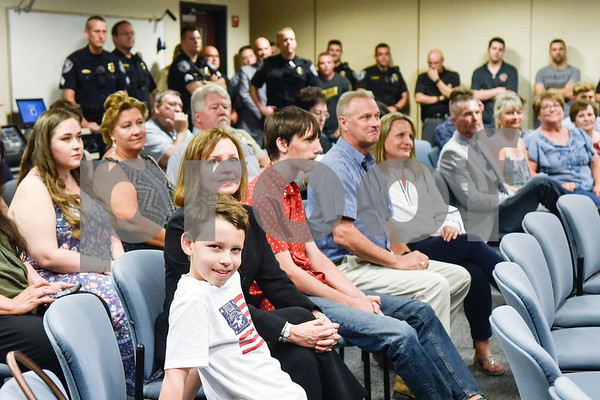 Friends and family watch the new recruits being sworn in at the Tyler Police Department in Tyler, Texas, on Tuesday, Sept. 4, 2018. Seven new police recruits were sworn in and received their badges during the ceremony. (Chelsea Purgahn/Tyler Morning Telegraph)