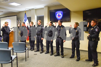 Police chief Jimmy Toler swears in the new recruits at the Tyler Police Department in Tyler, Texas, on Tuesday, Sept. 4, 2018. Seven new police recruits were sworn in and received their badges during the ceremony. (Chelsea Purgahn/Tyler Morning Telegraph)