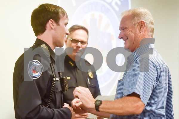 Thomas Jenkins is pinned with his new badge at the Tyler Police Department in Tyler, Texas, on Tuesday, Sept. 4, 2018. Seven new police recruits were sworn in and received their badges during the ceremony. (Chelsea Purgahn/Tyler Morning Telegraph)