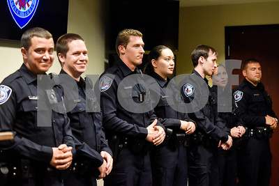New police recruits wait to be sworn in at the Tyler Police Department in Tyler, Texas, on Tuesday, Sept. 4, 2018. Seven new police recruits were sworn in and received their badges during the ceremony. (Chelsea Purgahn/Tyler Morning Telegraph)