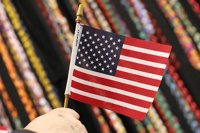 A handheld flag is displayed against a backdrop of paper chains during the celebration of kindness and service on Veterans Day. The event was sponsored by 11Alive, Georgia Natural Gas and the Home Depot Foundation.