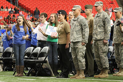 The audience cheers members of the armed forces as they make their way to the floor of The Georgia Dome, Atlanta. The second hour of the program, which celebrated kindness and service, paid tribute to our military veterans.