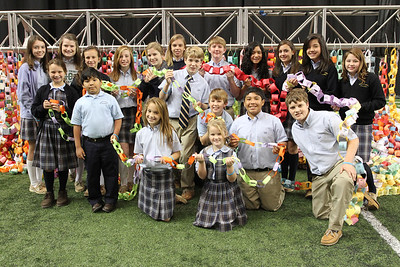 Holding their symbolic paper chains, with each link representing a singular act of kindness, fourth through eighth graders of Queen of Angels School, Roswell, attend the celebration of kindness and service at The Georgia Dome, Nov. 11.