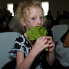 A photo of Katie being goofy at the wedding reception. She was pretending to be a bunny rabbit eating lettuce.