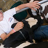 Record-Eagle/Douglas Tesner<br /> Jordan Strope, 14, takes a moment to relax with his Dairy Feeder calf at the Northwestern Michigan Fair.