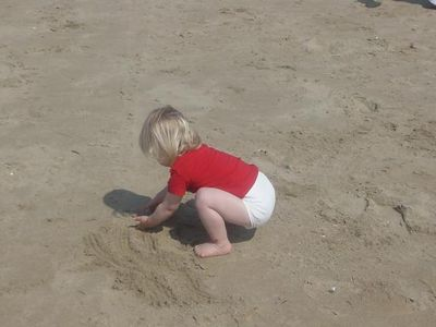 NO! Playing with the sand is much more fun!