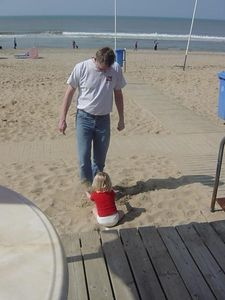 Throwing sand over daddies feet is fun too!