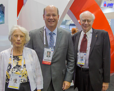 Carol, CoP CEO Ryan Lance, and John