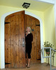 Vicki enters the dining room through a gorgeous 19th century door purchased at an auction in Oahu.