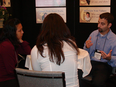 Eric provides career counseling services to student visitors at FASEB MARC booth during the ABRCMS 2004 meeting.