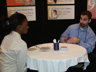 Eric provides career counseling services to student at ABRCMS 2004 meeting.