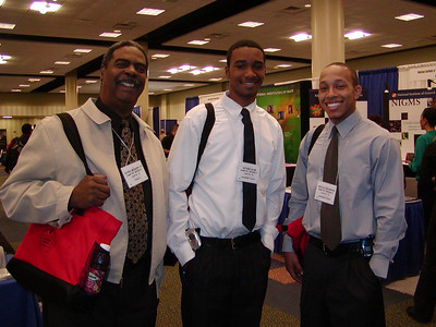 Dr. Alfred McQueen and his students/mentees, Arthur and Marcus (Hampton University) - FASEB MARC travel award recipients - at ABRCMS 2004 meeting.