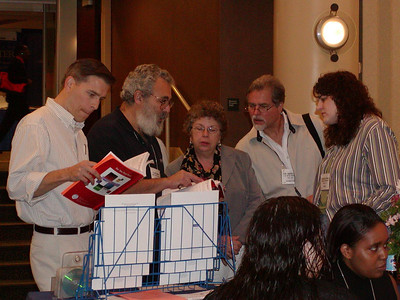 Dr. Judy Venuti (center) and others review results of developmental biology poster competition at ABRCMS 2004.