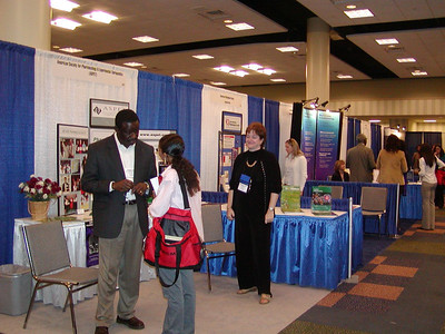 Visitors at ASPET's booth - ABRCMS 2004 with Dr. Christie Carrico.