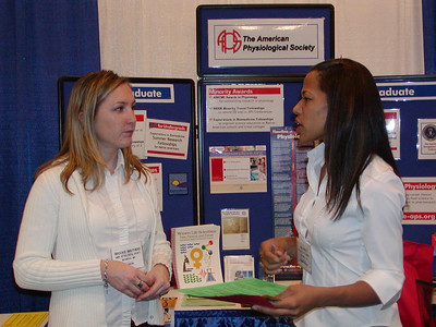 SDSU student, Nia Price, visits with Brooke Bruthers at APS's booth - ABRCMS 2004 meeting