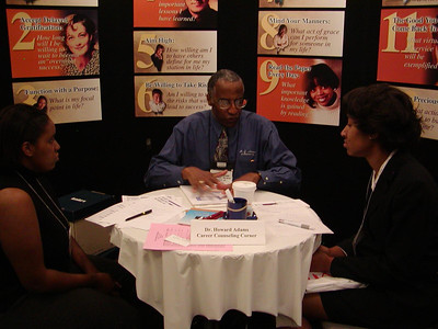 Der. Adams chats with student at ABRCMS 2004